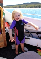 Poppy chuffed with her hand me down wetsuit