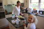 Poppy cooking with her aunties