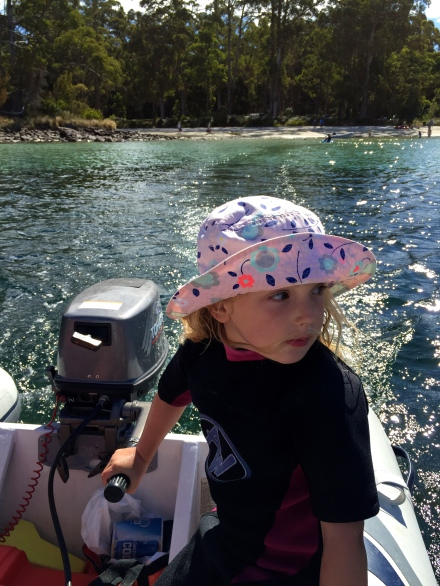 Poppy driving the dinghy